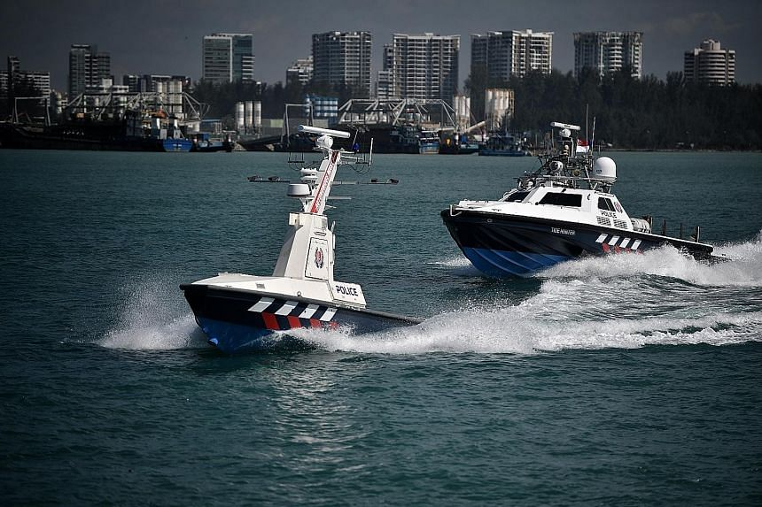The Police Coast Guard's unmanned surface vessels look like ordinary patrol boats but are loaded with cameras, radar, sensors, search lights and loud-hailers.
