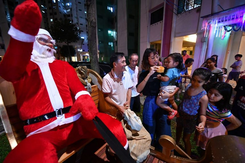 Mr Tan Koon Tat gives out Christmas presents to residents.