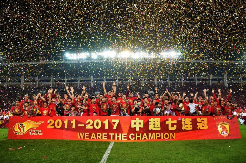 Guangzhou Evergrande players celebrate after winning the Chinese Super League (CSL) football tournament in Guangzhou, on Oct 22, 2017.