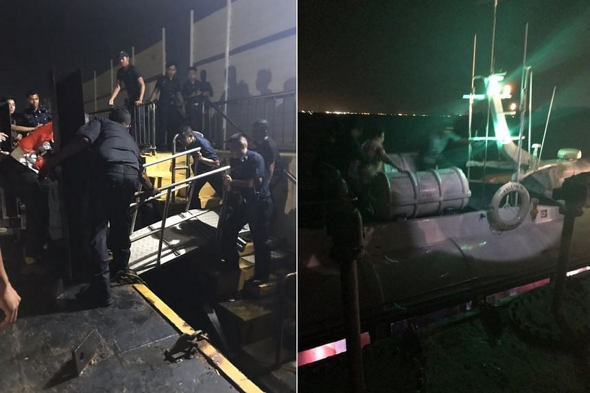 Police officers helped passengers disembark from the stranded ferry, who reportedly had to climb out from the roof.