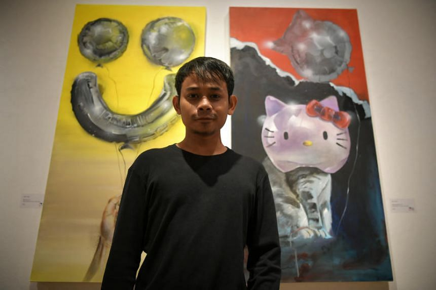 Artist Nur Iman with his works, on display at the Kontemporari 2017 exhibit.