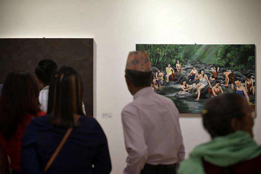 Guests attend the Kontemporari 2017 exhibition at the Ion Art Gallery, on Dec 23, 2017.