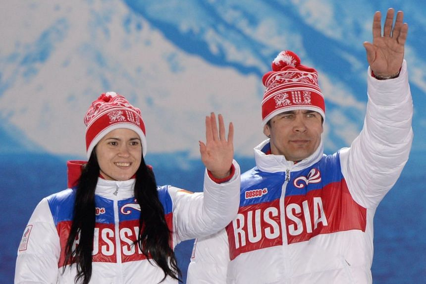 Silver medalists Tatyana Ivanova and Albert Demchenko pose during the medal ceremony in Sochi.