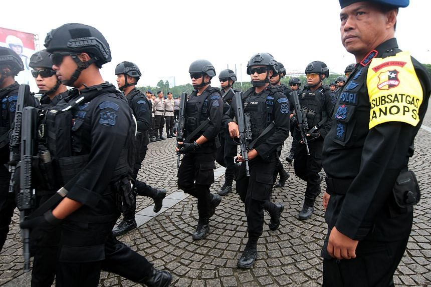 Members of an Indonesian anti-terror police unit line up during a drill at the National Monument in Jakarta.