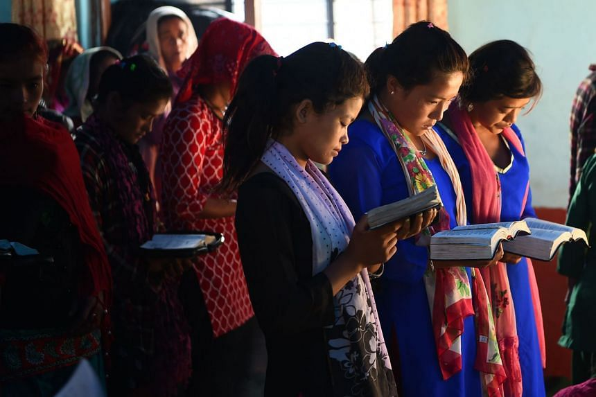 Nepali Christians take part in a church service in Lapa village in Dhading, on Oct 8, 2017.