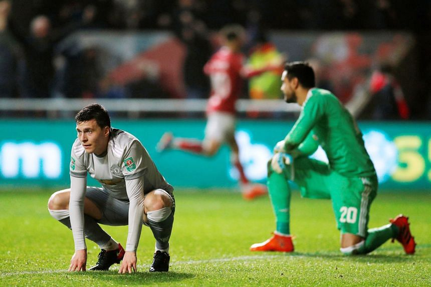 Manchester United's Victor Lindelof (left) and Sergio Romero looking dejected after Korey Smith scored Bristol City's second goal in their 2-1 League Cup win in midweek. Both are not expected to play for United today.
