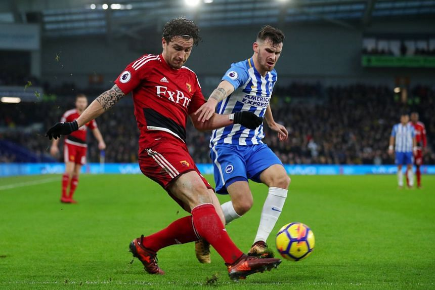 Watford's Daryl Janmaat in action with Brighton's Pascal Gross.