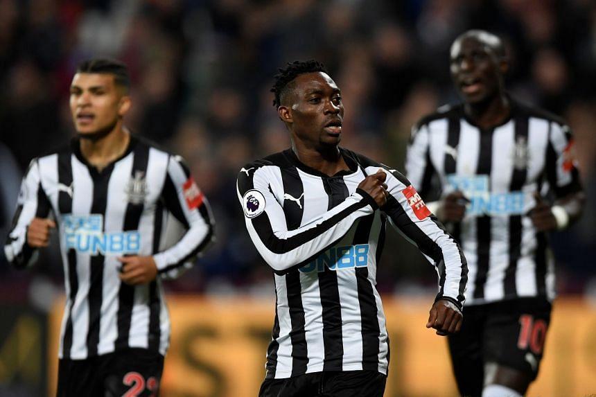 Newcastle United's Christian Atsu celebrates scoring their third goal.