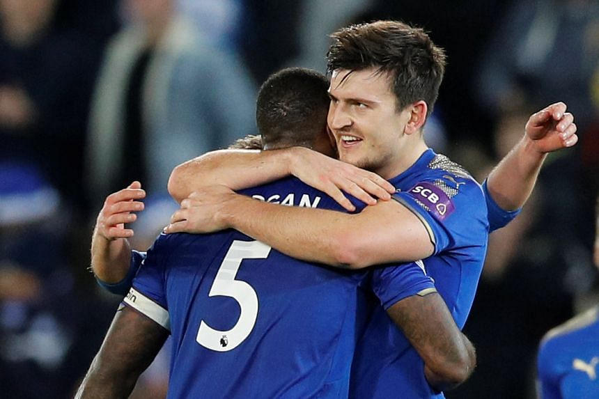 Leicester City's Harry Maguire celebrates after the match with Wes Morgan.