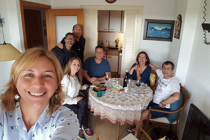 Mr Felix Bonet Nieto (in white T-shirt) with his family back home in Barcelona. Mr Bonet is upset by the majority of pro-independence groups after last Thursday's vote in Catalonia to elect a new regional Parliament.