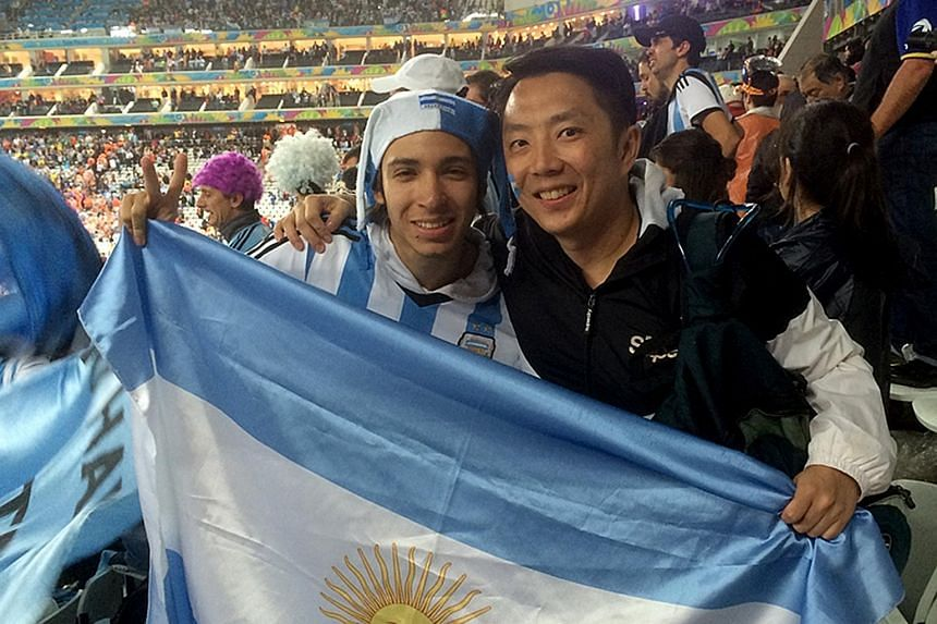 IT professional Justin Foo (left) at the 2014 World Cup semi-final between the Netherlands and Argentina. The 41-year-old will buy tickets from online reseller Viagogo, which is frowned upon by Fifa, if he cannot get them through official channels. M