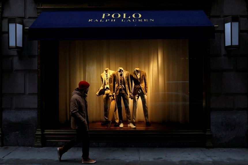 A man walks past Ralph Lauren Corp.'s flagship Polo store on Fifth Avenue in New York City.