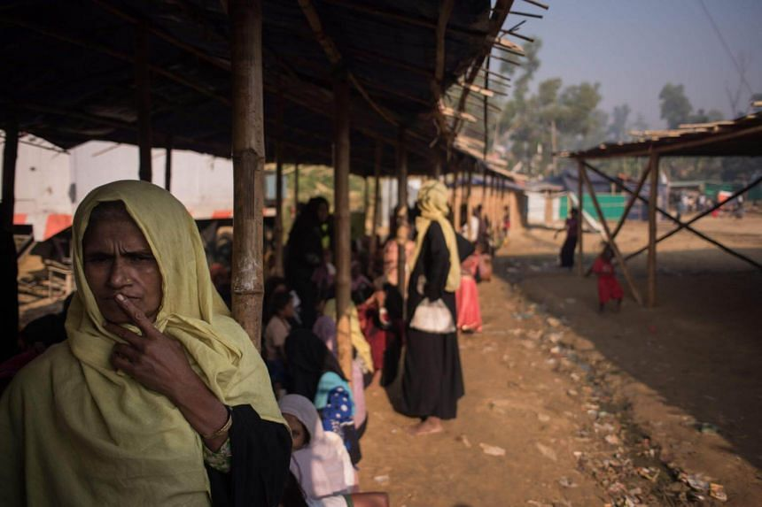 A Rohingya woman queues at a relief centre at the Jamtoli refugee camp in Cox's Bazar, on Nov 28, 2017.