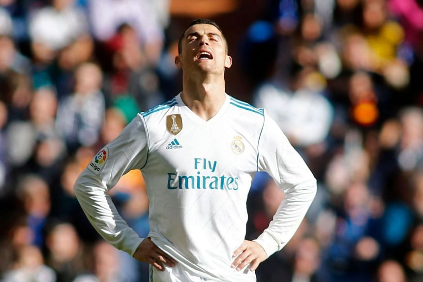 Real Madrid's Portuguese forward Cristiano Ronaldo reacts during the match.