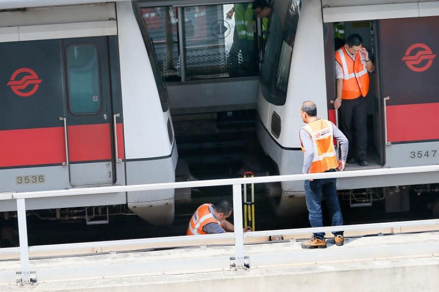 SMRT officials examining the two trains which had collided at Joo Koon MRT station on Nov 15, 2017.