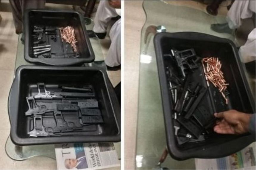 Pakistani authorities seized four pistols, eight ammunition magazines and 70 bullets hidden in the man's bag and shoes.