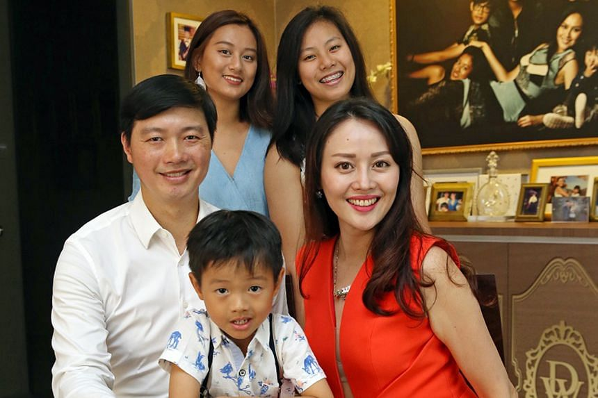Ms Wendi Chan, managing director of Parlour Group, and her husband Derrick Seeto, with three of their four children here – Francesca Naila (left), 19, Annabelle Kamilah, 15, and Don Seeto, four. Son Adiro, 17, is studying in an International school