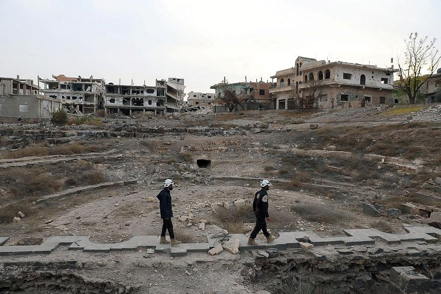 Members of the Syria Civil Defenceinspecting the damage at a Roman ruin site in Daraa.
