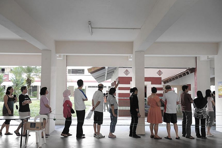 Voters waiting for their turn at a polling station in Hougang during the 2011 General Election. When the Electoral Boundaries Review Committee is convened months before a general election, the ELD, which celebrates its 70th anniversary this year, doe