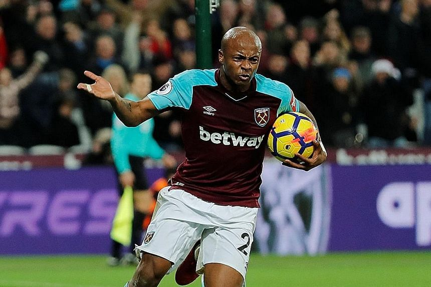 Left: West Ham's Andre Ayew celebrates his strike in the 69th minute, but it did not atone for his awful 56th-minute penalty miss on Saturday. Right: Ayew's brother, Jordan, also got into the scoring act with a late leveller for Swansea against Cryst