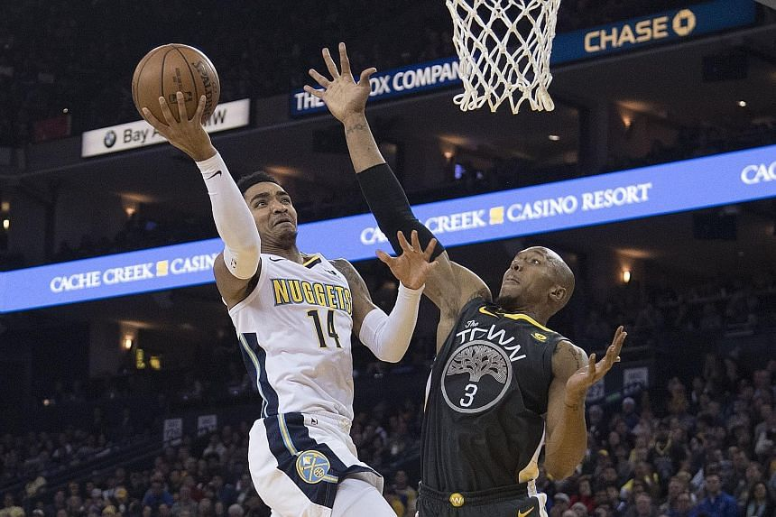 Denver Nuggets guard Gary Harris going up for a shot as Golden State Warriors forward David West defends. Harris' 19 points made him the top scorer in the game at Oakland, which the visitors won 96-81.