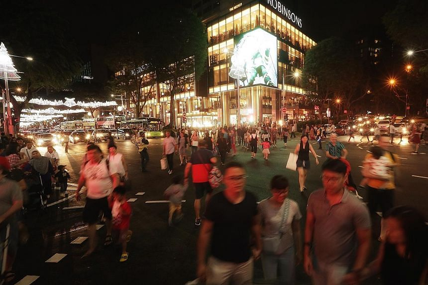 Pedestrians crossing the Cairnhill Road-Orchard Road intersection on Dec 16, the first day of a month-long scramble crossing trial.