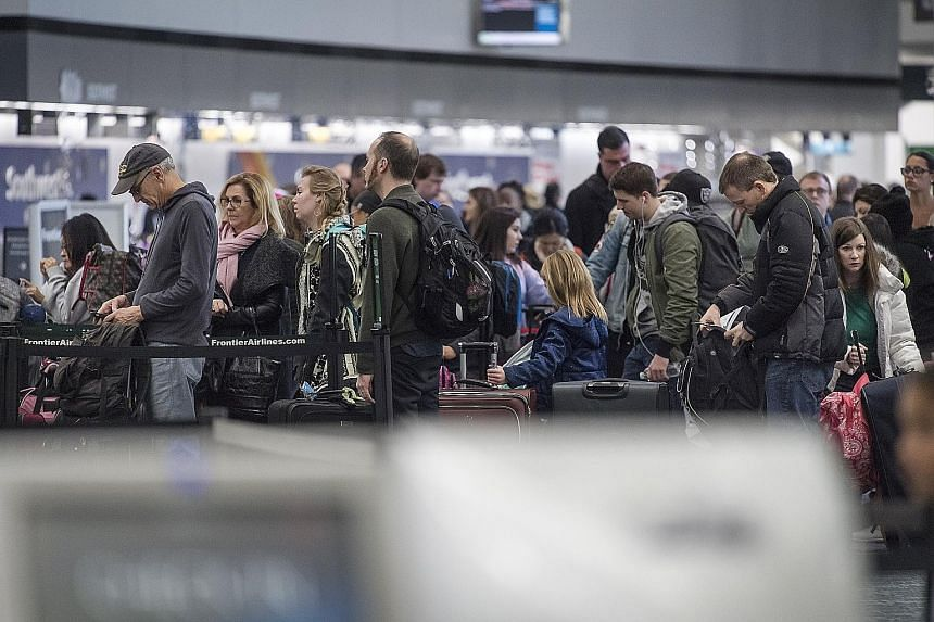 Passengers at a Southwest Airlines check-in counter at San Francisco International Airport last Saturday. The United States will register the highest year-end travel volume on record from last Saturday to Jan 1, with 107 million Americans expected to