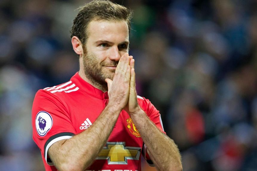 Manchester United's Spanish midfielder Juan Mata celebrates after scoring his, and United's second goal during the English Premier League football match between Leicester City and Manchester United in Leicester on Dec 23, 2017.