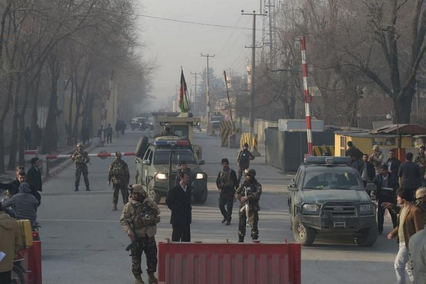Afghan security personnel cordoning off a road near the site of a suicide attack in Kabul on Dec 25, 2017.