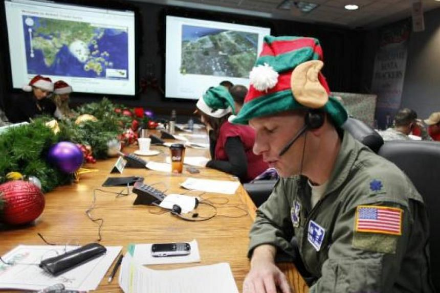 Air Force Lt. Col. David Hanson, of Chicago, takes a phone call from a child in Florida at the Santa Tracking Operations Center at Peterson Air Force Base near Colorado Springs, on Dec 24, 2010.