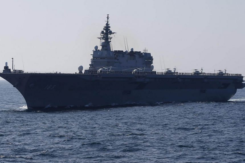 The Izumo military helicopter carrier of the Japan Maritime Self-Defence Force during a fleet review at Sagami Bay, off Yokosuka, south of Tokyo.
