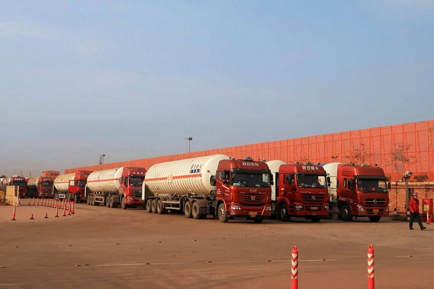 A file photo of gas trailers lining up to fill liquefied natural gas at Caofeidian terminal, in Tangshan, Hebei province, China.