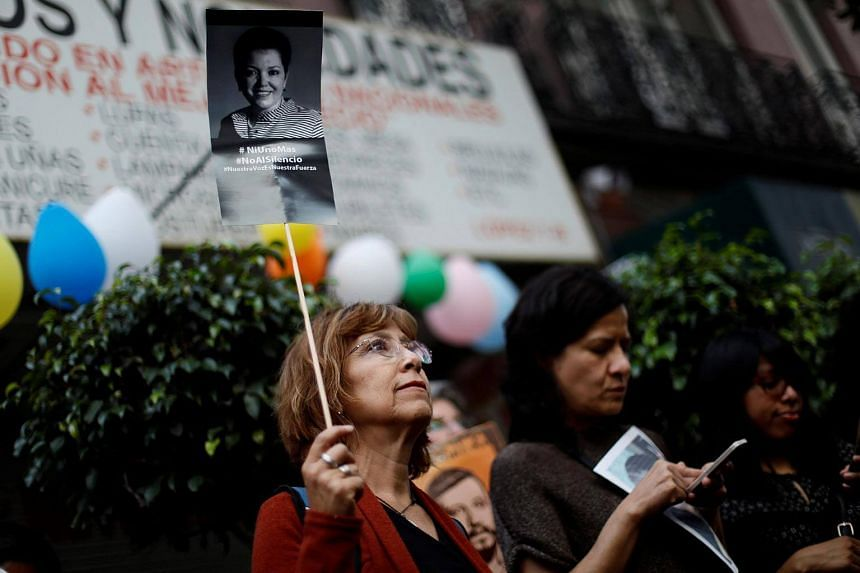 A woman holds up a photo of journalist Miroslava Breach during a demonstration against the murder of journalists in Mexico, on June 15.