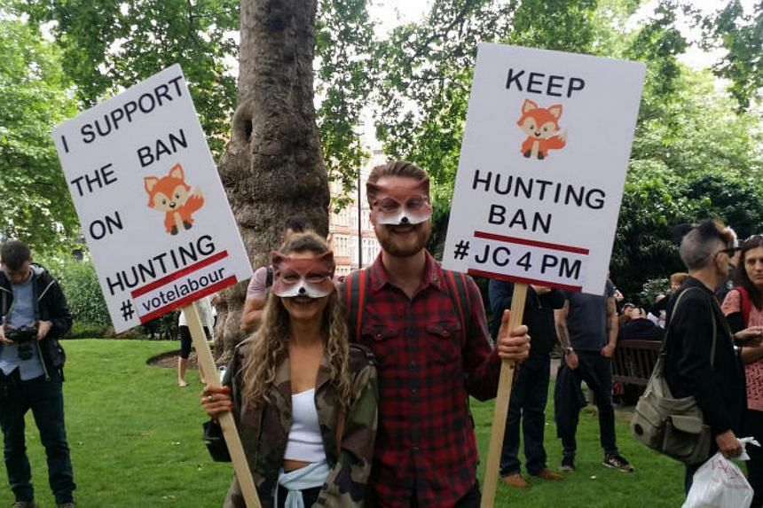 People protesting against fox hunting at a march in London in May 2017.