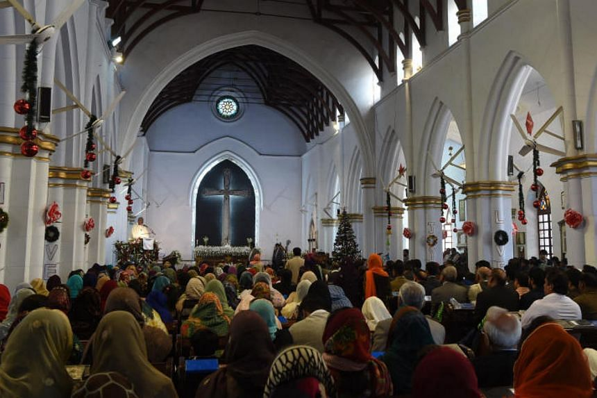 Pakistani Christians attend Christmas Day mass at a church in Peshawar on Dec 25, 2017.
