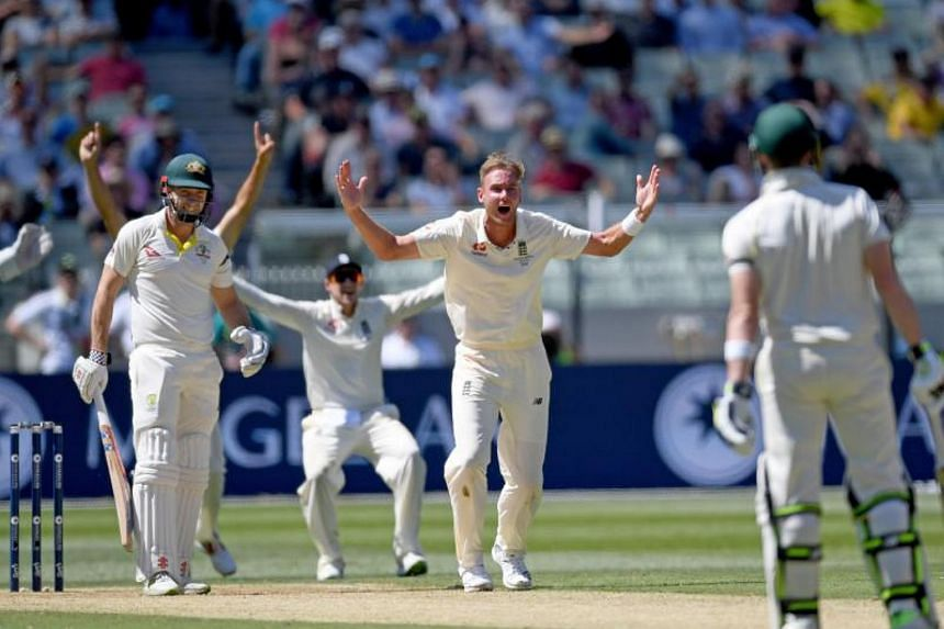 English bowler Stuart Broad (centre) appeals to the umpire for the wicket of Shaun Marsh of Australia on Day One of the Boxing Day Test match between Australia and England at the Melbourne Cricket Ground (MCG) in Melbourne on Dec 26, 2017.