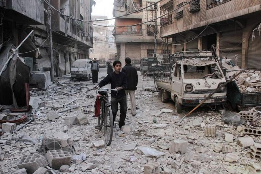 Destruction in the rebel-held town of Douma, in Syria's eastern Ghouta region, following reported shelling by Syrian government forces on Nov 17, 2017.