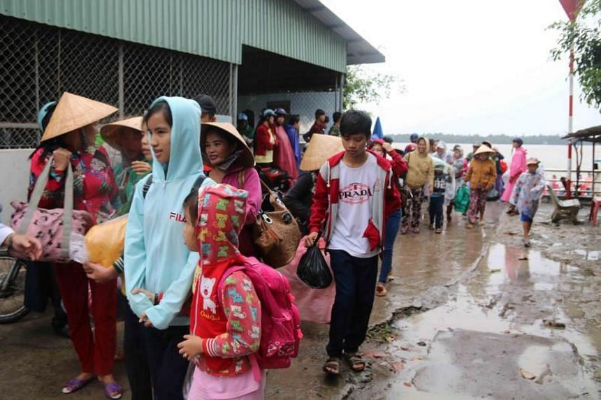 Residents evacuating as Tropical Storm Tembin approaches in Tra Vinh, Vietnam, on Dec 25, 2017.
