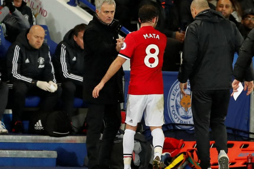 Manchester United's Juan Mata with Manchester United manager Jose Mourinho after being substituted at the King Power Stadium, Leicester, Britain on Dec 23, 2017.