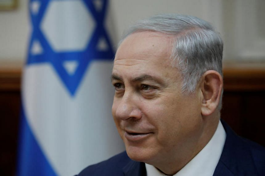 Israeli Prime Minister Benjamin Netanyahu attends the weekly cabinet meeting at the Prime Minister's office in Jerusalem on Dec 24, 2017.