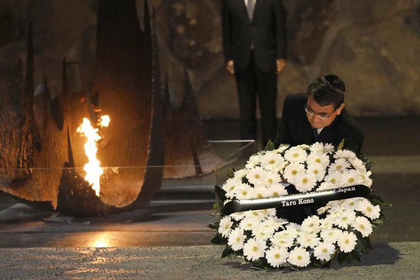 Japanese foreign minister Taro Kono lays a wreath at the Hall of Remembrance at the Yad Vashem Holocaust memorial museum in Jerusalem, on Dec 25, 2017. Kono is on an official visit to Israel.
