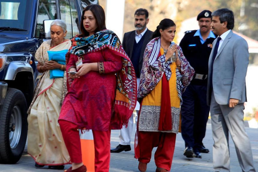 Former Indian navy officer Kulbhushan Sudhir Jadhav's mother Avanti (left) and wife, Chetankul, (3rd from right) arrive to meet him at Ministry of Foreign Affairs in Islamabad, Pakistan on Dec 25, 2017.