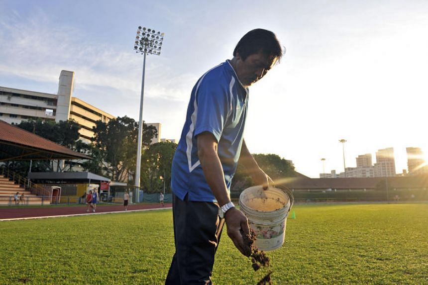 Lambri Moondari, 66, seen here on the Hougang Stadium pitch in 2013 sprinkling dirt onto areas that require filling in, died on Dec 25 due to complications from a head injury after a fall.