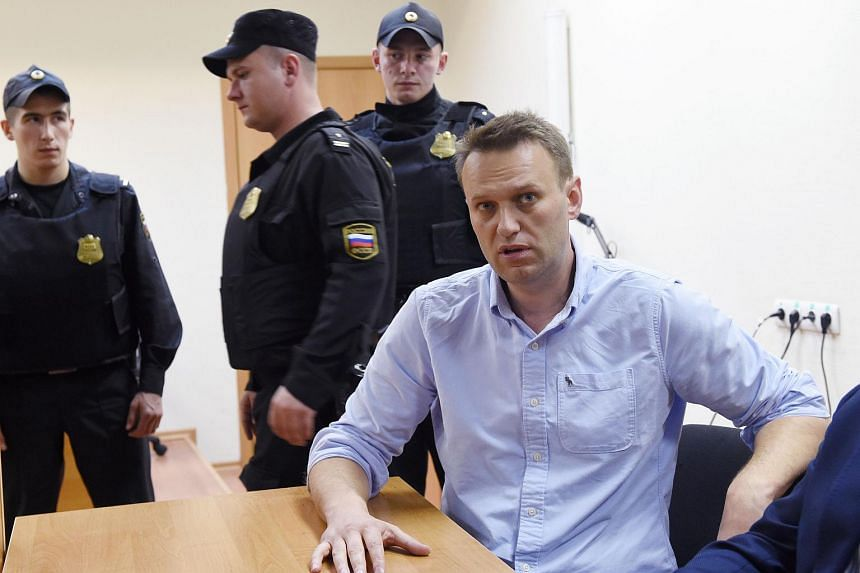 Russian opposition leader Alexei Navalny speaking after a hearing in a court in Moscow on June 12, 2017.