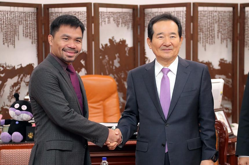 South Korean Speaker Chung Sye Kyun (right) poses for a picture with visiting Filipino boxer and Senator Manny Pacquiao at the National Assembly in Seoul, on Dec 22.