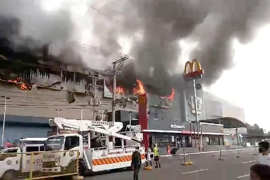 Smoke rises from burning mall's 3rd floor, in Davao City, Philippines.