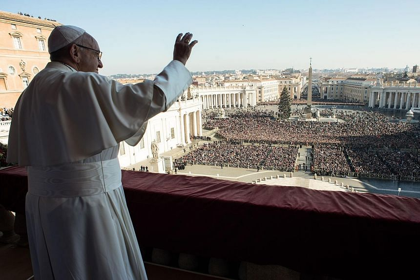 Pope Francis greeting worshippers from the balcony of St Peter's Basilica as he gave his traditional address on Christmas Day. His message was delivered hours after a Christmas Eve mass where he urged Catholics not to ignore the conditions migrants f