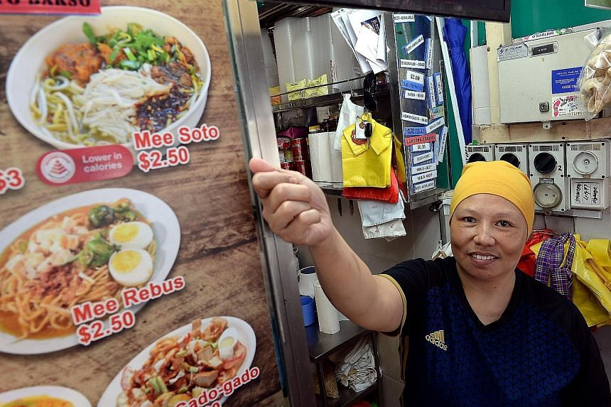 Madam Julina Ahmad's stall in New Upper Changi Road offers healthier options. The Health Promotion Board has expanded the Healthier Dining Programme, so people can easily identify the better option.