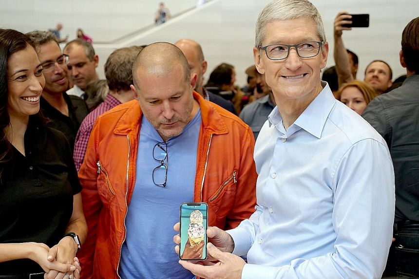Apple's CEO Tim Cook (right) and design chief Jony Ive with the iPhone X at a US media event in September.