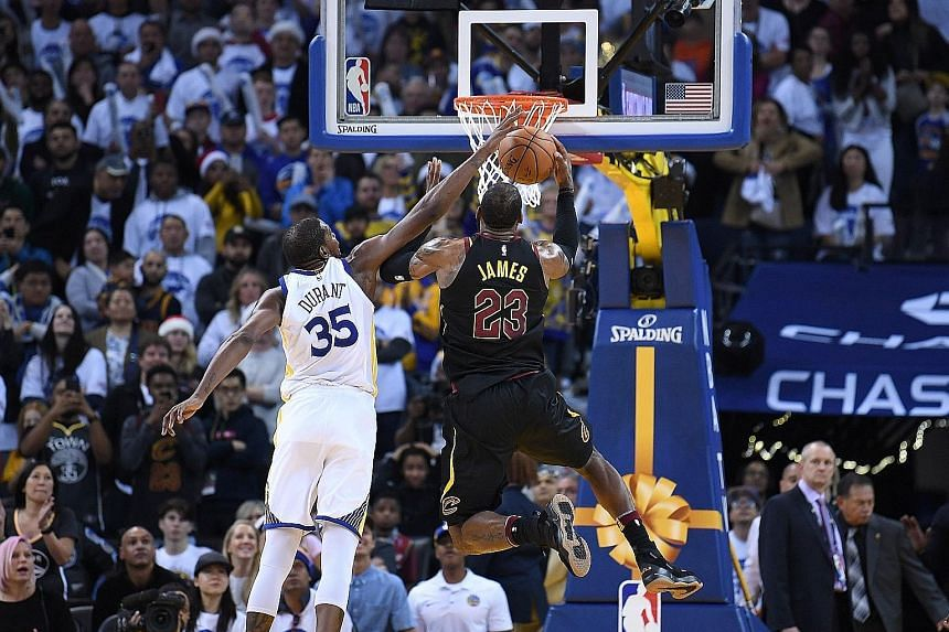 Golden State Warriors' Kevin Durant blocking LeBron James of the Cleveland Cavaliers with 24.5sec to go as they held on to win 99-92 on Monday in Oakland. The Cavs forward took umbrage with the officials' call, believing he was fouled, with the ball